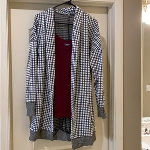 Black and white checked cardigan with grey detail.